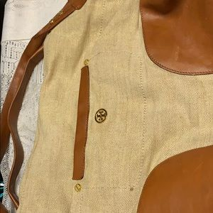 Tory Burch canvas and leather handbag .